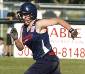 by: David Ball Gresham's Lexi Baty runs to third base during a state tournament game. The Gresham squad finished second.