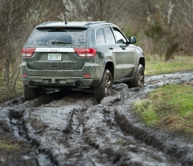 by: NORTHWEST AUTOMOTIVE PRESS ASSOCIATION Deep mud was no problem for the 2011 Jeep Grand Cherokee at this year's Mudfest off-road competition.
