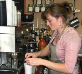 by: Jim Hart Kelly Campbell adds flavor to a latte at her coffee bar. After experience as a barista and baker, Campbell is putting her knowledge to work at Café Coco.