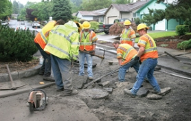 by: Jim Clark City of Gresham workers tear up old asphalt to make way for new paving on Southwest Birdsdale Avenue on Tuesday, July 19.