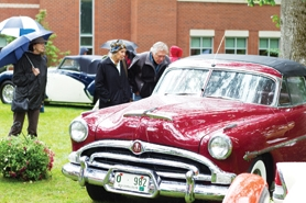 by: John Schrag Painstakingly restored to its original condition, this convertible Hudson Hornet wowed Concours-goers Sunday with its radiant maroon finish. The car was featured on the cover of this year's Concours d'Elegance literature.
