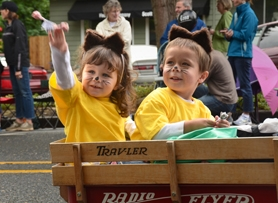 by: VERN UYETAKE Zoe, at left, and Coleton Bengtson throw candy to parade onlookers as part of the West Linn Community Preschool entry in Saturday's Old Time Fair parade.