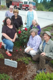 by: SUBMITTED PHOTO West Linn Garden Club members pose with newly rededicated Firefighter roses at the Bolton fire station. Clockwise from left are Constance Weaver, Elaine Mahoney, Jane Sercombe, Maret Frye, Jo Longacre, Gail Gibbard and George Jankowski.