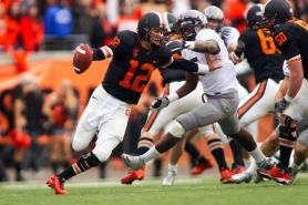 by: CHRISTOPHER ONSTOTT Oregon State quarterback Ryan Katz, trying to elude the Oregon defense in the 2010 Civil War, says he is fully healed from right wrist surgery and has been leading informal summer workouts.