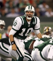 by: NICK LAHAM Erik Ainge calls signals for the New York Jets in a 2009 preseason game against the St. Louis Rams.