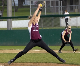 by: DAN BROOD POWER PITCHER — Tualatin City's Camryn Robbins gets ready to fire a pitch to the plate during the team's 5-2 win over Forest Grove in district play on Monday.