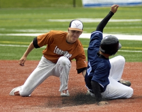 by: DAN BROOD CAUGHT STEALING — Tigard shortstop Tucker Campbell (left) tags out Dr. Barney's Chris Ignozedo on a stolen base attempt during Saturday's game at Tigard High School. The Longhorns scored a 5-4 victory.