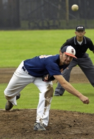 by: DAN BROOD BRING THE HEAT — Suburban Door's Nick Bland fires in a pitch during Monday's game with Taylor Electric. Bland pitched the Dawgs to a 4-0 victory.
