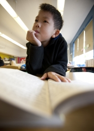 by: CHRISTOPHER ONSTOTT Zhiyi Tam, 9, reads aloud during a PDX Summer School lesson at Harrison Park School. The half-day, four-week program helps students learning English as a second language keep their skills sharp during the summer.
