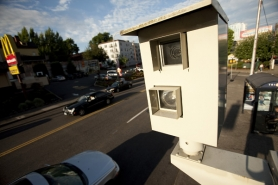 by: CHRISTOPHER ONSTOTT That bug-eyed monster at West Burnside Street and 19th Avenue takes more photographs of drivers running red lights than any other red light camera in Portland. Since the camera has been in place, collisions at the intersection have dropped dramatically.