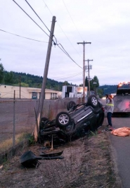 by: SUBMITTED PHOTO This 2006 Jeep Liberty went off the east side of Highway 99E south of Oregon City early Thursday morning, overturned and hit a power pole.