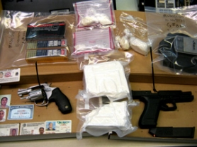 by: Contributed photo Investigators found a kilo, or 2.2 pounds of cocaine, two handguns, one of which was stolen out of Portland, and reportedly confiscated several fake and forged identification documents during a search of a home in East County.