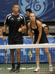 by: BRIAN SQUIERS Travis Parrott (left) and Martina Hingis plot strategy.