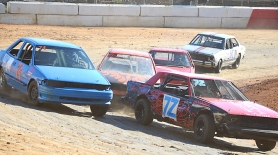 by: John Brewington TIGHT PACK—Racers in the second heat of the Mini Stock (4-cyclinder) Division were close from start to finish. Joel Beehler (third above) would emerge as the winner as four cars cross the finish line in a near dead heat. Beehler would go on to win the main event.