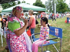 by: Contributed photo Kids of all ages enjoy face painting by Lotta the Clown.