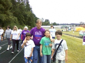 by: SADIE MAIN Chase Sager, Alex Youse, Colby Sager and Don Sager walk in the 2011 Relay for Life.