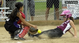 by: DAN BROOD STEALING HOME — Tualatin City's Brooke Clinton (right) slides safely to home plate as Willamette catcher Dominique Deo reaches for the ball on a stolen base attempt in Monday's game at the state tournament.