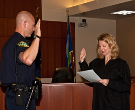 by: SUBMITTED PHOTO Mike Stradley is sworn in as the West Linn Police Department's newest cop.