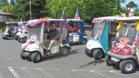 by: Barbara Sherman HOORAY FOR THE RED, WHITE AND BLUE — Bob Olmstead leads off the parade from the King City Clubhouse parking lot and also acts as grand marshal and traffic controller.