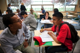by: CHRISTOPHER ONSTOTT Tedros Abraham (left), community engagement coordinator for the Portland Schools Foundation, talks with incoming David Douglas High School freshman Jose Santos about how he can get involved in school activities in the fall. The foundation's
