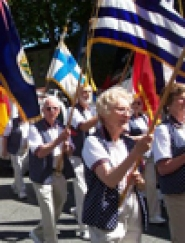 by: Mary Thibert LIONS ON PARADE – As part of the 94th annual Lions Clubs International Convention in July, members participated in a parade, carrying flags of different countries; and Bill Gerkin (at rear) carries the flag of Greece.