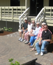 by: Barbara Sherman ENJOYING THE RESULTS – The Summerfield project includes a circular patio, and seated on a new bench are (from left) Bob Van Vlack, Evelyn Yardley, Edward Stern, Mary Kerns, Sharon Hughes and Paul Ochs.