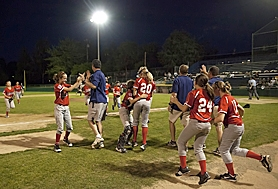 by: BECCA QUINT WINNERS — Willow Creek's players and coaches rush the field after beating Tualatin City on Friday to earn a berth in the Little League World Series.