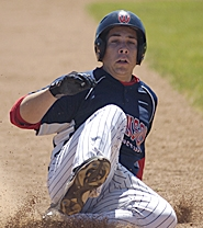 by: David Ball DOWN AND DIRTY — Robinson Construction's Marcus Rethwill slides into third base during his team's 10-7 win over Sandy on Saturday at Westview High.