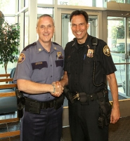 by: David F. Ashton Retiring Commander Bill Walker, left, greets Portland Police Chief Mike Reese at East Precinct.