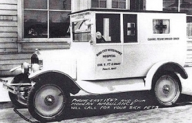 "by: Courtesy of Dr. Craig Quirk Dr. Gustav H. Huthman, the founder of Rose City Veterinary Hospital a century ago, converted a 1923 Studebaker truck into an emergency vehicle that was advertised as a ""Canine and Feline Coach"". This is how it appeared on an advertising postcard."