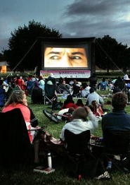 "by: David F. Ashton As the sun sets, another ""Movie in the Park"" rolls."