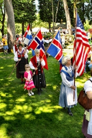 by: David F. Ashton Flag-bearers, led off with the flag of the United States, represent the heritage of their respective Scandinavian countries.