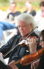 by: Jim Clark Marshall Tuttle plays violin with the Mt.Hood Chamber Strings on Monday, July 18, during Music Mondays at Center for