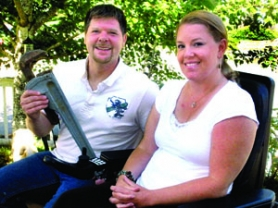 by: Jim Hart Scott (holding large pipe wrench) and Jennifer Horsfall, owners and operators of Living Water Plumbing, have been chosen as Sandy's home-based business of the year. The award will be presented at noon Wednesday, Aug. 10, by the Sandy Area Chamber of Commerce.