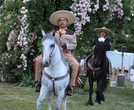 by: SUBMITTED PHOTOS / TRAVIS HENDRICKS Benjamin Garcia, left, Ismael Alvarez entertain the crowd on their horses after dinner. Many attendees also took rides with them around a ring.