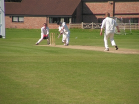 by: SUBMITTED PHOTO Michael Charno swings during a cricket match in England.