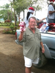 by: contributed photo Mark Nelson, shown distributing Christmas toys in Tambor, Costa Rica, got involved in the education system there after building the Tambor Tropical hotel. The son of a school teacher, he's a strong believer in preschool education.