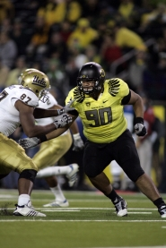 by: © 2011 ERIC EVANS Defensive lineman Ricky Heimuli, 6-4 and 320 pounds, passed on his Mormon mission to play for the Oregon Ducks this season and help support his family in Utah.