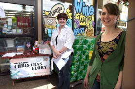by: Jaime Valdez Friends Jennifer Fair of King City and Renee Atkins of Tigard stand in front of the King City Grocery Outlet to raise money for their nonprofit organization Operation Christmas Glory.