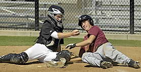 by: Dan Brood CLOSE CALL — Tigard catcher Brody Parsons (left) holds up the ball after tagging Tonkin Nissan's Taylor Bonawitz in the third inning of last Thursday's OIBA tourney game. Bonawitz was safe on the play.