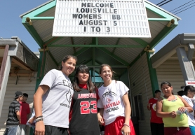 by: Jaime Valdez Shoni Schimmel, left, and her sister Jude, both former Franklin High basketball stars, pose Friday with Kaylee Fragua in front of Nixyaawii Community School Gym on the Confederated Tribes of the Umatilla Reservation in Pendleton. The Schimmels and the Louisville Cardinals basketball team are on a 10-day tour of the Pacific Northwest.