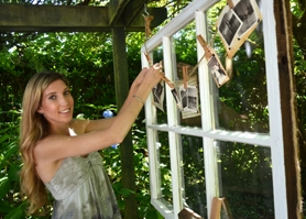 by: VERN UYETAKE Rebecca Logsdon hangs family photos on a strand of twine affixed to a vintage window — a personalized take on wedding décor.