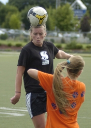 by: David Ball Sandy's Makena Schroder goes over a Newberg midfielder for a header during last week's summer-league game at Gresham High School.