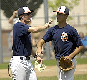 by: Dan Brood ON THE JOB — New Tualatin High School baseball coach Adam Strachan (left) congratulates Cooper Brunner following an OIBA game this summer.