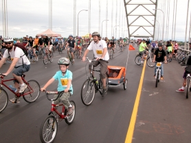 by: Gail Park Bicyclists from across the region rolled across the top deck of the Fremont Bridge during Sunday morning's 16th annual Providence Bridge Pedal. About 18,000 people took part in the event. Some stopped to take photos in the cool morning from the top of the bridge.