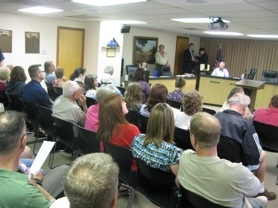by: RaYMOND RENDLEMAN Citizens packed Gladstone's City Council chambers Aug. 9 to hear elected officials approve library plans and information about related petitions.