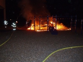 by: clackamas County Sheriff's Office Clackamas Fire personnel work to extinguish a suspicious fire that completely destroyed Bilquist Elementary's play structure in Milwaukie on Monday night.
