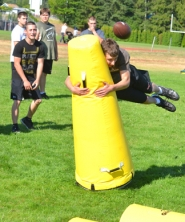 by: John Brewington FLYING TACKLE—Brody Shaw of Scappoose dives at a tackling dummy and then will recover the fumble during a Spirit Week drill at Scappoose High School last week. The Indians are holding a camp all week and start practices next week.