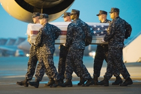 by: U.S. Air Force Photo by Steve Kotecki A U.S. Navy team carries the remains of hospitalman Ryley Gallinger-Long, of Cornelius, off a transport plane at Dover Air Force Base in Delaware Saturday. Assigned to a Marine Expeditionary Force, Gallinger-Long died in action in Afghanistan Aug. 11.