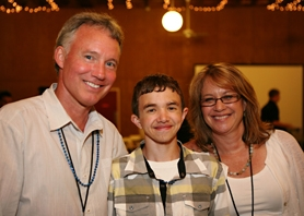 by:  Jayne Dearborn and Chris Dearborn – co-founders of the Blue Butterfly Campaign – visit with Justin Lambert, 18, at center, who was the guest speaker at last week's fundraiser for acute myeloid leukemia (AML). Lambert is an AML survivor.